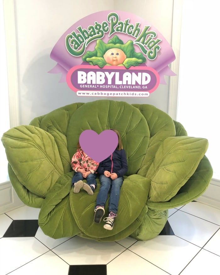 BabyLand photo op in a large plush cabbage. If you're curious about the American birthing culture during the majority of the 1900s, you're in luck.  BabyLand General Hospital, the birth place of the iconic cabbage patch dolls, is a unique time capsule not only for the children of the 80s, but also, unfortunately, the height of the medicalization of childbirth.