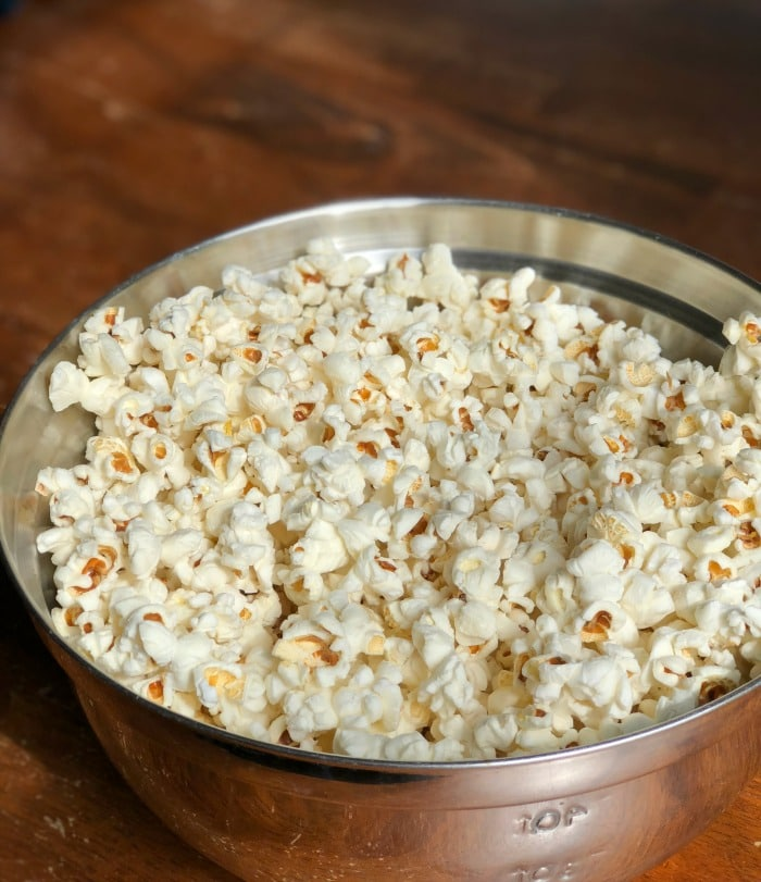 By using my step-by-step instructions you will have perfectly popped coconut oil popcorn made on the stove with minimal (if not zero!) unpopped kernels. Life goals, people! Let's get started.